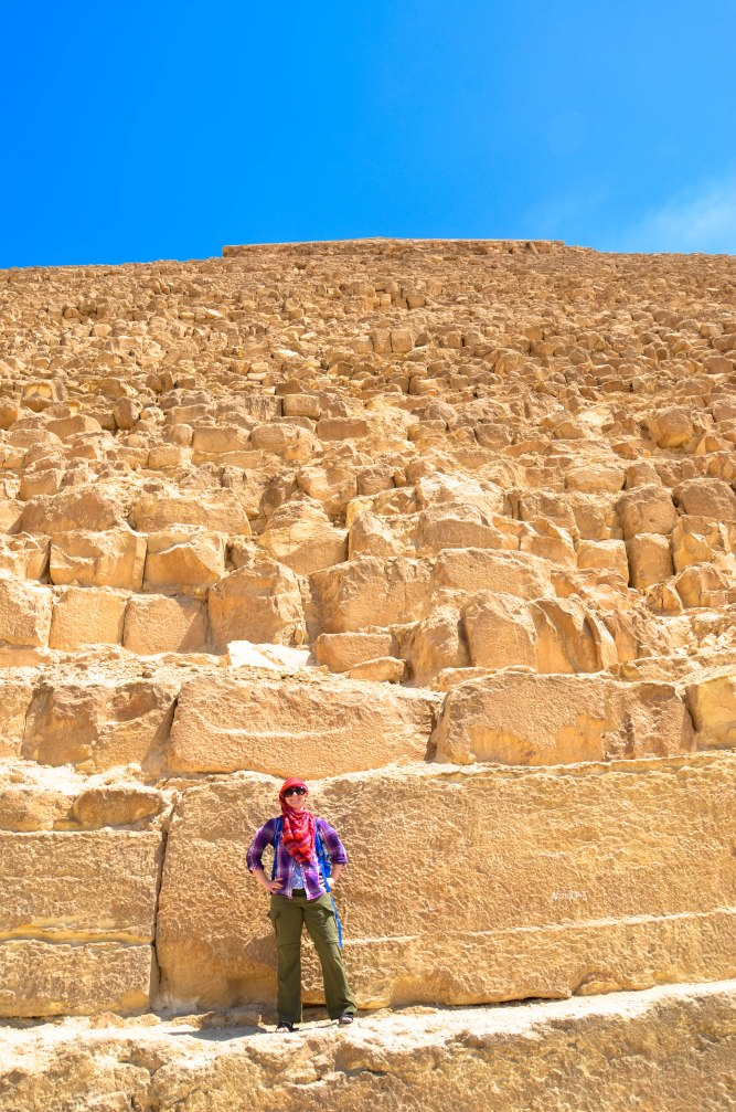 Standing on pyramid