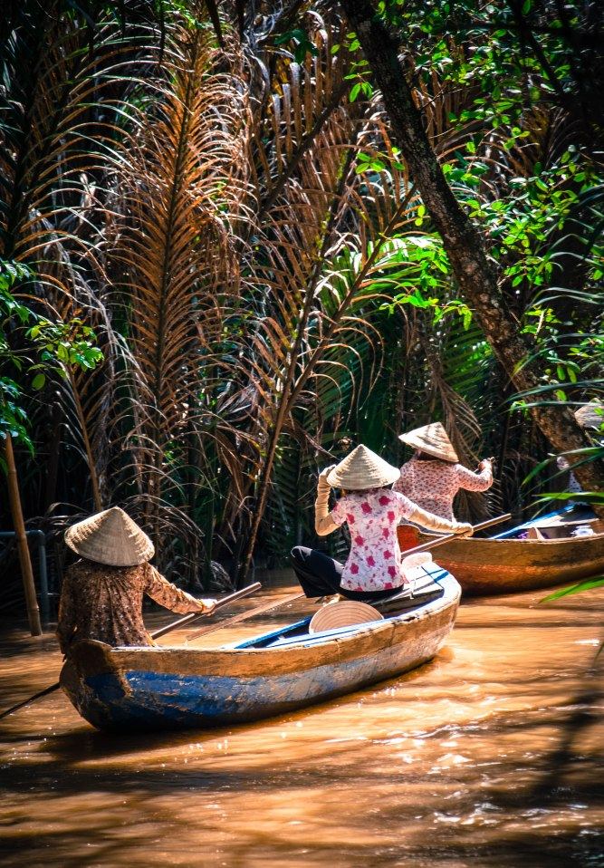 Ladies on a Mekong River canal